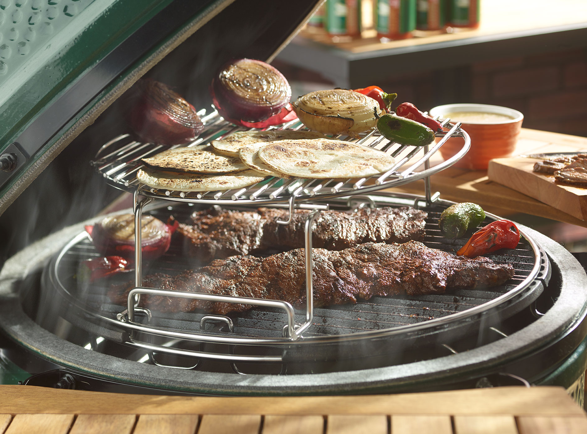An image of a big green egg grill in use.