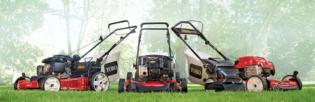 A set of 3 lawn Toro mowers.